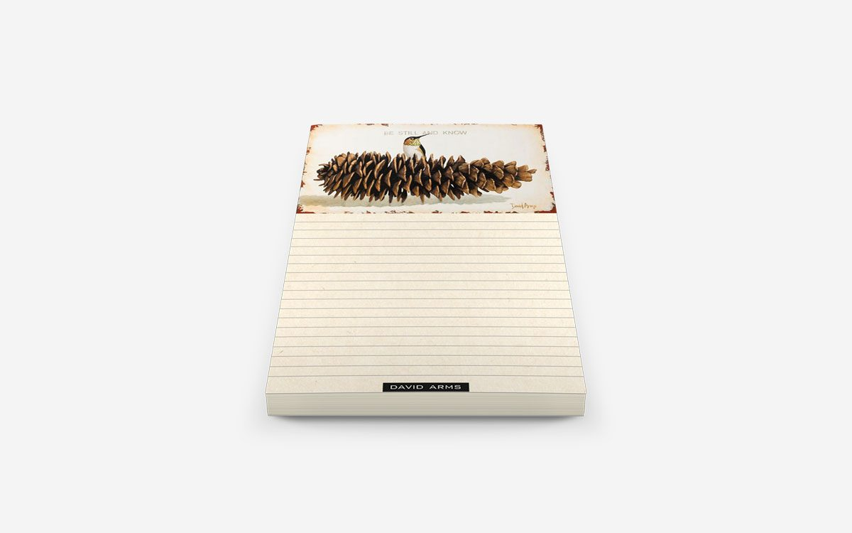 be-still-and-know-pine-cone-notepad-product-gallery-image-angled